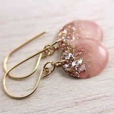 Pink resin drop earrings with gold glitter and gold leaf on gold earwires.  NOTE: ANYONE WHO TRIES TO PUT THEIR ADVERTISING ON ANY OF MY PINS WILL BE REPORTED FOR SPAM!     . . . .   ღTrish W ~ http://www.pinterest.com/trishw/  . . . .   #handmade #jewelry