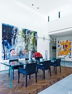 Paintings by Marilyn Minter (left) and Jean-Michel Basquiat (far right) energize the dining room at baseball star Alex Rodriguez's family home just outside Miami, Florida. | archdigest.com
