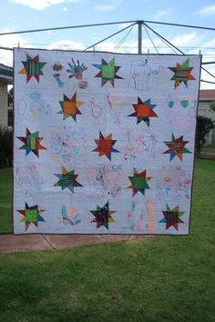 bushfire quilt 2 by quiltcraft -- star quilt with alternating blocks of pictures drawn by children... so cute!