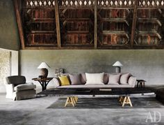 Axel Vervoordt--Photo AD_Munich --- Barn-seating-area-and-table_.jpg