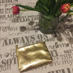 """Lancôme gold clutch A small, graceful clutch for makeup or a fun night out. 7.5"""" by 5"""", would easily hold a cell phone, lipstick and a few credit cards. Lancome Bags Cosmetic Bags & Cases"""