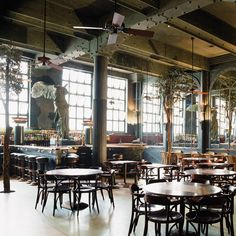 Alcantara café, Lisbon, Portugal.  Timeless restaurant because of the size of its industrial architecture.