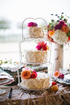 simple tiered white cake with flowers set on tiered plate stand #weddingcake #cakestand #weddingchicks http://www.weddingchicks.com/2014/01/24/true-love-texas-wedding