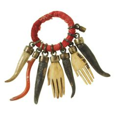 Pitt Rivers Museum, Oxford.  Looks like Italian charms of red coral, several hornos or hornitos, and hands.