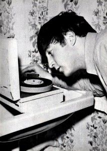 """July 1963. John playing a Parlophone test pressing of the Twist and Shout"""" EP, Margate hotel."""