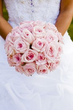 We love this wedding bouquet full of pink roses! {Photo courtesy of Epic Events}