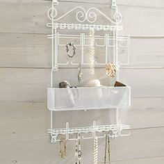 """Never misplace another piece of jewelry again. This unique Jewelry Organizer hangs from the wall or door back and keeps your entire collection in easy reach.  • dimensions: 31 ½""""H x 21""""W x 4""""D • hardware included • 16 hooks for 100+ necklaces • 12 bars for 75+ bracelets & watches • 10 posts for over 50 rings • earring board • accessories tray • white powder-coated steel • it's a great companion to our other closet organize..."""