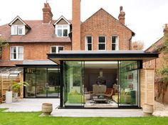 Flat roof design exterior modern with sliding glass doors glass wall brick house Extension Veranda, House Extension Design, Extension Designs, Glass Extension, Roof Extension, Single Storey Extension, Extension Ideas, Extension Google, Modern Exterior