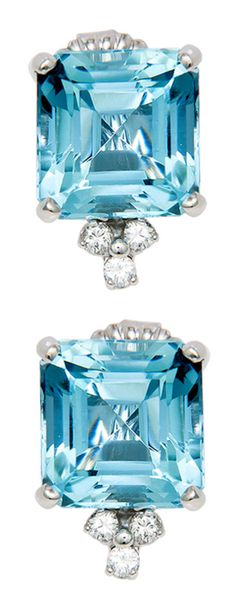 Aquamarine and diamond earrings, circa 1970's. Circa: 1970s 14K White gold, Diamond and Very Fine color Aquamarine earrings. Each Aquamarine being step cut, measuring 10 1/2 X 10 1/2 M.M. For a total weight of 11 Carats.