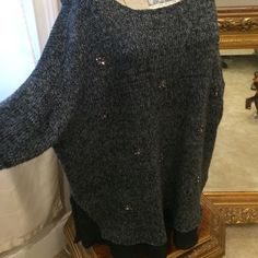 """Oversize sweater w/ """"slip"""" and rhinestone accents Black gray and metallic done well. This boyfriend sweater has enough feminine accents to make it super glam. Touches of rhinestone, silver thread throughout the sweater itself, and the little see-through peekaboo slip at the bottom hem. Wear it scoopneck or off the shoulder. Can be worn as a dress or with leggings Jessica Simpson Sweaters"""