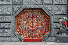 Photo about Traditional Chinese style door at a temple. This door has eight sides and is red in color. It is decorated in traditional Chinese style. Image of grey, entrance, lion - 14624347