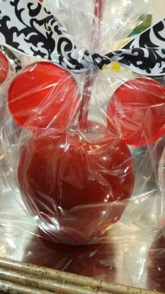 Silhouette Mickey candy apples made by @one_skinny_baker