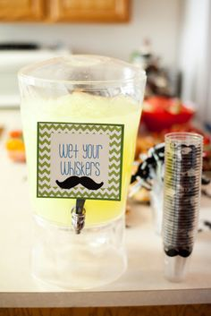 mustache baby shower: drink sign- I have this dispenser and we could use a blue drink.