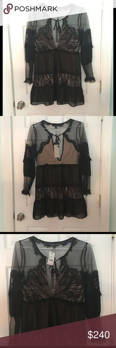"""🆕For Love & Lemons Alexa Lace-Inset Mini Dress This dress is NWT! Gorgeous black mesh and lace dress. Partially lined with nude lining at top and under skirt. Keyhole neckline with tie closure. Long sheer sleeves. Approximately 17 1/2"""" across the bust when laid flat and 32 1/2"""" from shoulder to hem. Self:  100% polyester, Contrast:  43.7% cotton, 38.3% nylon, 18% rayon For Love and Lemons Dresses Mini"""