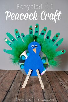 Turn an old CD into this pretty Recycled CD Peacock Craft for Kids.