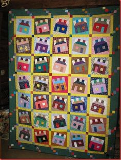 Margaret F. made this Happy Scrappy Houses quilt, seen on quiltville.com/blogspot, from a Bonnie Hunter pattern.