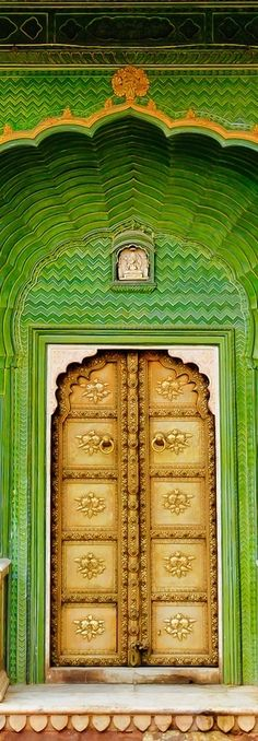 """One of the four gates at Pritam Chowk in the City Palace, Jaipur, India. Each gate represents one of the four seasons. The Green Gate, also called Laheriya (meaning: """"waves"""") Gate, represents spring. Cool Doors, The Doors, Unique Doors, Windows And Doors, Entry Doors, When One Door Closes, Closed Doors, Door Knockers, Doorway"""