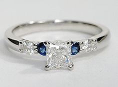 This striking setting features two brilliant diamonds alternating with two vivid blue sapphires for the perfect complement to the centre diamond of your choice. 1/5 carat total diamond weight.