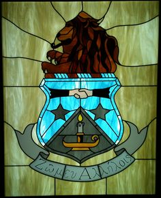 Stained glass. Would be a beautiful dedication gift for a chapter anniversary.