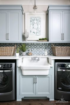 Laundry room farmhouse sink between washer and dryer. Laundry room with grey blue cabinets, painted in Silver Mink by Benjamin Moore, patterned tile backsplash and farmhouse sink . Artisan Signature Homes Laundry Room Sink, Basement Laundry, Laundry Room Storage, Laundry Room Design, Laundry Rooms, Laundry Area, Luxury Interior Design, Home Interior, Interior Ideas