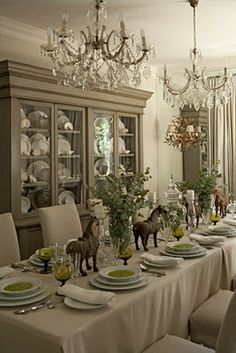 Tablescape -  the horses and the greens against the beige.  French Country Dining