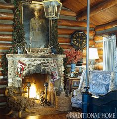 A rustic stone fireplace is right at home in a log cabin. We love the addition of the oversize wing chair in blue toile. - Traditional Home ® / Design: Charles Faudree Rustic Elegance, Rustic Style, Country Decor, Rustic Decor, Rustic Design, Cabana, Natal Country, French Country Christmas, Country French