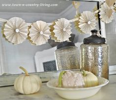 Paper fan garland tutorial via Town and Country Living {though i must say i object to removing pages from books}