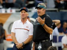 Chicago Bears head coach John Fox, left, talks to Philadelphia Eagles head coach Doug Pederson before an NFL football game, Monday, Sept. 19, 2016, in Chicago.