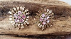 Vintage Lisner Signed amazingly bright clear rhinestone earrings with gold toned floral setting screw back earrings by SteamyAntiquities on Etsy