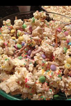 Bunny bait !  2 cups pretzels 1 bag popped white popcorn 1 package Almond Bark white melting chocolate 1 bag of festive M&M's 2 cups of Chex cereal 1 container of sprinkles Spread pretzels , popcorn and Chex on an foil covered bakinig sheet and drizzle white chocolate over the mixture ... Gently stir to coat evenly ... Add sprinkles but don't stir it anymore or the sprinkles will be coated with chocolate and turn white ... Let harden on cookie sheets and then break apart and add M&M's to…