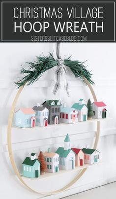 DIY Christmas Villag DIY Christmas Village Hoop Wreath tutorial - make this set of paper houses using the Cricut Maker and display them on a large wooden hoop with shelves. Diy Christmas Lights, Noel Christmas, Modern Christmas, Christmas Paper, All Things Christmas, Christmas Ornaments, Diy Christmas Wall Decor, Christmas Mantles, Whimsical Christmas