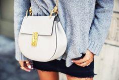 Gray sweater, Chloé Drew bag, and a mini skirt