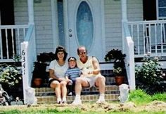 This ghost picture shows a mysterious figure staring at a happy family outside.