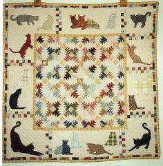 Cats (and People) Who Quilt - love the tiny pineapple blocks with the various cats around it. This wall hanging is about the width of a twin bed.