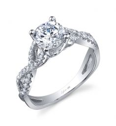 This dazzling 18K white gold diamond engagement ring features a 1.00 carat round brilliant center diamond. Beautifully designed to accentuate the center diamond, this engagement ring has a total of 0.26 carats of round diamonds flowing down this uniquely designed shank setting. The diamond engagement ring is available in any size or shape center, in 18K white gold or platinum. All Sylvie Collection engagement rings are available with a flush fit matching wedding band. (For pricing on this…