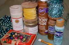 Natalie Loves...: Do-it-yourself glittered Christmas houses--Here are some of the supplies you'll need:  crystal coarse glitter, glass glitter, tacky glue, acrylic paints, vintage inspired tinsel, and whatever embellishments you choose.