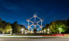 https://flic.kr/p/ouJnpA | The Atomium in Brussels, Belgium |  Buy this photo on Getty Images : Getty Images   The Atomium is a building in Brussels originally constructed for Expo 58, the 1958 Brussels World's Fair. Designed by the engineer André Waterkeyn and architects André and Jean Polak, it stands 102 m (335 ft) tall. Its nine 18 m (59 ft) diameter stainless steel clad spheres are connected so that the whole forms the shape of a unit cell of an iron crystal magnified 165 billion…