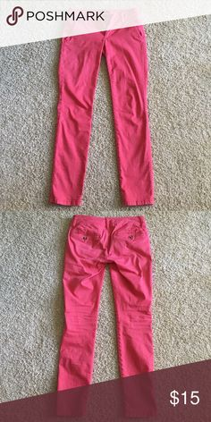 American Eagle pink straight leg trousers American Eagle pink straight leg skinny trousers.  Pockets on the front & back, good condition - fun for changing up your work attire.  Size 0 Short. American Eagle Outfitters Pants