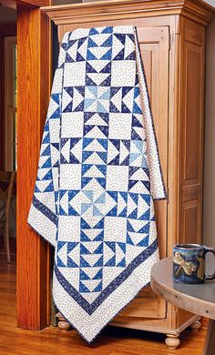 Two-color quilts are timeless - this bed-size quilt pattern is no exception. It's easy to make, with large Flying Geese and Pinwheel blocks in diagonal rows.