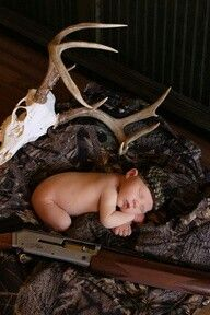If this baby wakes up, he will never go back to sleep for fear of a gun toting spiky monster that's gonna get him.