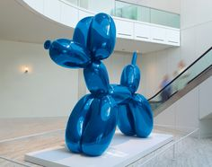 """Jeff Koons, """"Balloon Dog (Blue)"""", 1994-2000, mirror-polished stainless steel with transparent color coating, 121 x 143 x 45 in."""