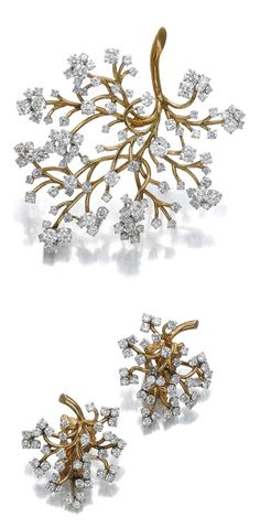 DIAMOND DEMI-PARURE, 'CAPILLAIRE', VAN CLEEF & ARPELS, 1960S.  Comprising: a clip brooch of branch design, set with circular-cut diamonds and a pair of clips en suite, may be worn as ear clips or dress clips, each piece signed Van Cleef & Arpels and numbered, each with French assay and maker's marks, one small diamond deficient.