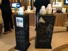"What a great idea to display special auction items.  ""These display stands for the Silent Auction were painted in Chalkboard paint.  We then turned the kids loose with some chalk.  Just another reminder to guests, why we are there."""