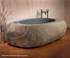 Bathtub hand-crafted out of natural stone.