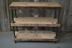 Items similar to Industrial Reclaimed Wood Console Table shelves) on Etsy Shelves, Industrial Furniture, Wood Shelving Units, Reclaimed Wood Console Table, Reclaimed Wood Shelves, Wood Furniture Plans, Wood Diy, Wood Furniture Diy, Vintage Industrial Furniture