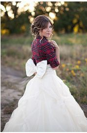 You gotta love the bow and the plaid for a fun fall or winter wedding! REVEL: Plaid Flannel over a Wedding Dress