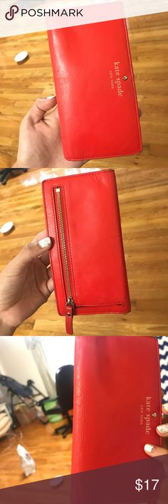 Kate spade Stacy PWRU2127 red wallet. Used condition: There's sign of wear on the corners of the wallet and some wrinkling as shown in the pic. Color is called flame (because it's bright red color). Cute wallet! Lmk if you need more pics. Not new but the tag is still there kate spade Bags Wallets