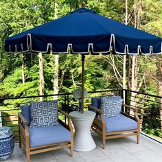 Designer Erin Gates of Elements of Style uses Frontgate's Calais Umbrella + Tambora Lounge Chairs in her space at the Atlanta Homes & Lifestyles Southeastern Showhouse.