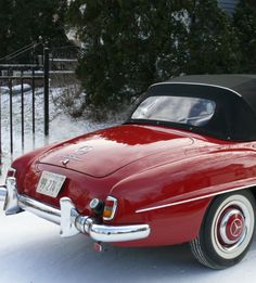Mercedes Roadster in Cherry Red.