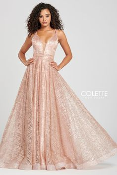 Colette for Mon Cheri CL12008. Sleeveless cracked ice a-line gown with a plunging v-neck, natural waistline, crisscross back and a horsehair trim at the hem